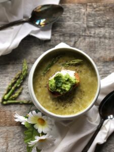 Fresh asparagus and pea soup with ricotta and smashed pea and mint crostini